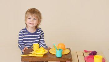 Happy Child Cooking Pretend Food